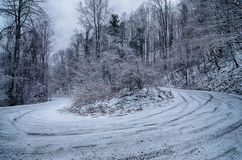 S curve road in the mountains after winter snow storm Royalty Free Stock Photos