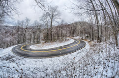 S curve road in the mountains after winter snow storm Royalty Free Stock Images