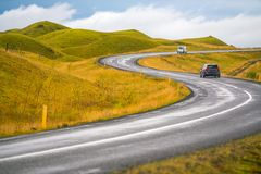 S-curve shape road in Iceland with mountain. In background stock image