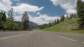 An S Curve in Wyoming mountains. An S Curve in Wyoming mountain road stock video footage