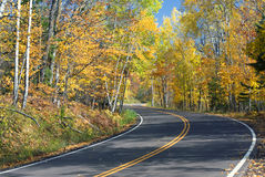 S-Curved road through autumn forest, Minnesota Royalty Free Stock Photos