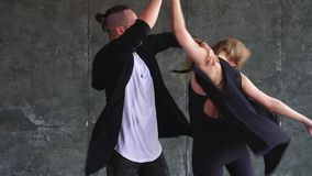 The 20s dancers are marvelously moving in grey dance class. Slow motion stock video