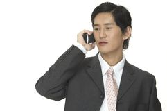 It's A Deal. An asian businessman makes an important business phone call Stock Photography