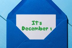 It`s December - sign on paper at open blue post envelope. Winter, Eve and New year time concept.  Royalty Free Stock Photography