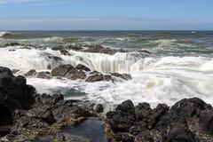 ` S di Thor bene a capo Perpetua, costa dell'Oregon fotografia stock libera da diritti