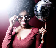 Disco girl. 70s disco girl with a disco ball and a big afro hair royalty free stock photography
