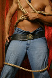 It's a draw. Male cowboy tangled in rope drawing his pistol royalty free stock photography