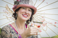 1920s Dressed Girl with Parasol and Glass of Wine Portrait Stock Image