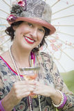 1920s Dressed Girl with Parasol and Glass of Wine Portrait Royalty Free Stock Photos