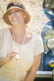 1920s Dressed Girl with Parasol Near Vintage Car Portrait Royalty Free Stock Photos