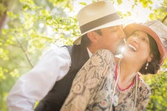 1920s Dressed Romantic Couple Flirting Outdoors royalty free stock photography