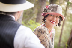 1920s Dressed Romantic Couple Flirting Outdoors royalty free stock image