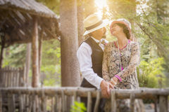 1920s Dressed Romantic Couple on Wooden Bridge stock images