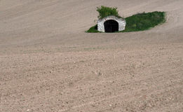 It´s dry. Old cellar in a dry field stock photography