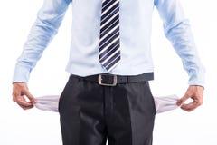S'est cassé et pauvre homme d'affaires avec les poches vides Image stock