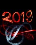 ` S EVE 2019 del nuovo anno con le luci astratte fotografia stock libera da diritti