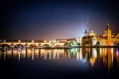 It`s evening in the city of Prague. View of the Charles bridge and star. Czech Republic Royalty Free Stock Photos