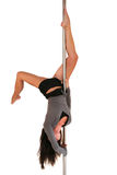 S factor. Young woman exercising pole dance fitness Royalty Free Stock Photos