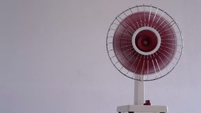 80`s fan in running on white background. stock video