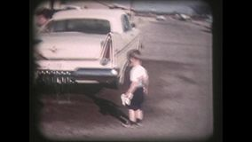 1950s Father And Son Wash Car - Vintage 8mm stock video
