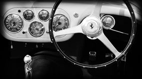 1950s ferrari interior dashboard gauges. 1950s Ferrari 133 Mille Miglia interior gauges and dashboard. outdoors under natural sunlight. monochromatic black and Royalty Free Stock Photos