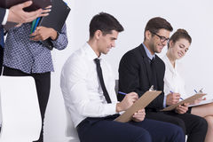 It's almost filled out. Shot of a smiling job applicants during a pre-employment screening Stock Photo
