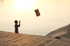 It`s flying !. A young indian boy is playing with his kite looking at it admired and hopeful Royalty Free Stock Photography