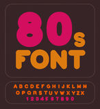 80s font. Retro alphabet. Vintage rounded alphabet. Disco Letter Stock Photos