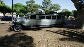 1930s Ford Limousine. Guildford, Swan Valley, West Australia - December 2017: side view of 1930s Ford Limousine. Stretch limo Model A used for wedding services stock video