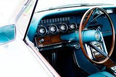 1960's Ford Thunderbird dash. 1960's restored blue Ford Thunderbird Stock Photo
