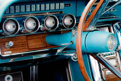 1960's Ford Thunderbird dash. 1960's restored blue Ford Thunderbird Royalty Free Stock Images