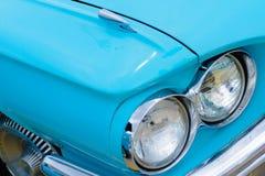 1960's Ford Thunderbird headlights. 1960's restored blue Ford Thunderbird Royalty Free Stock Photography