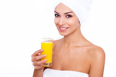 It's freshly squeezed!. Studio portrait of an attractive young woman holding a glass of orange juice Stock Images