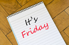 It's friday concept on notebook. It's friday text concept write on notebook stock images