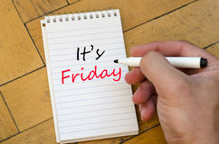 It's friday concept on notebook. It's friday text concept write on notebook royalty free stock photos