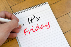 It's friday concept on notebook. It's friday text concept write on notebook stock photos