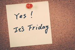 It's Friday. Note pin on bulletin board Royalty Free Stock Photography
