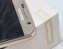 S6 front camera. Samsung Galaxy S6 64 GB gold platinum edition front camera close up Stock Images