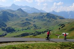 That`s fun: With a hired Trotinett downhill Sillerenbühl. Near Adelboden in the swiss alps Stock Photos