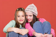 It's fun together. Two young girls smiling together Royalty Free Stock Images