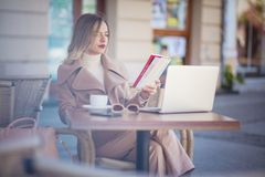She`s really getting into her book. Woman in the city royalty free stock images