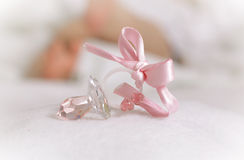 It's a Girl!. Macro Crystal baby soother with ribbon, It's a Girl, newborn on the background Royalty Free Stock Photography