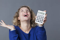 20s girl having fun and satisfaction of winning money. Accountant and financial situation concept - young woman celebrating her first financial win Royalty Free Stock Images