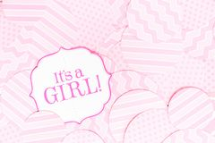It`s a girl sign at the baby shower party.  Pink patterns background.  Baby shower celebration concept Royalty Free Stock Photos