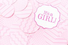 It`s a girl sign at the baby shower party.  Pink patterns background.  Baby shower celebration concept Royalty Free Stock Photo