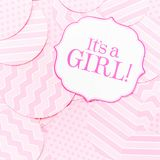 It`s a girl sign at the baby shower party.  Pink patterns background.  Baby shower celebration concept Stock Photo