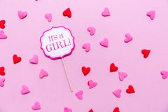 It`s a girl sign at the baby shower party.  Pink solid backgroun Stock Images