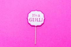 It`s a girl sign at the baby shower party.  Pink solid backgroun Royalty Free Stock Photos