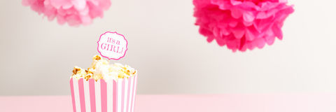 It`s a girl sign in a popcorn bag at the baby shower party.  Bab Royalty Free Stock Photos