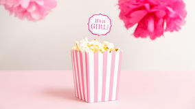It`s a girl sign in a popcorn bag at the baby shower party.  Bab Royalty Free Stock Photo